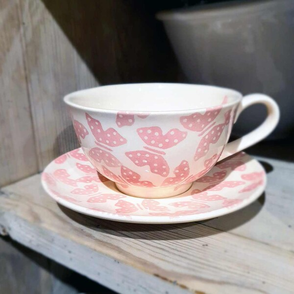 cup and saucer on shelf