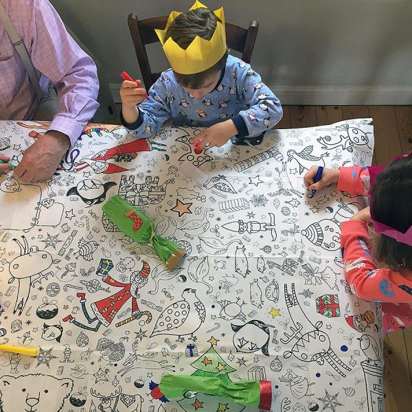 family sitting around table colouring tablecloth