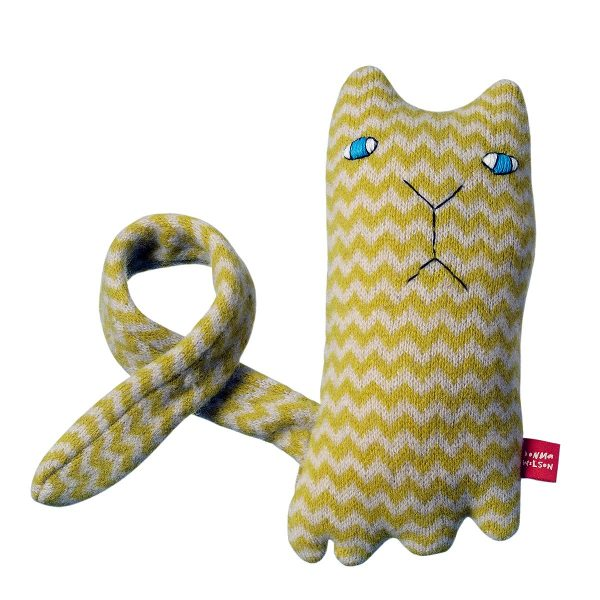 yello and white zig zag pattern toy cat on white background