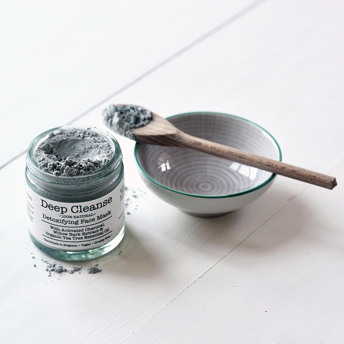 open jar and mixing bowl with spoon on surface