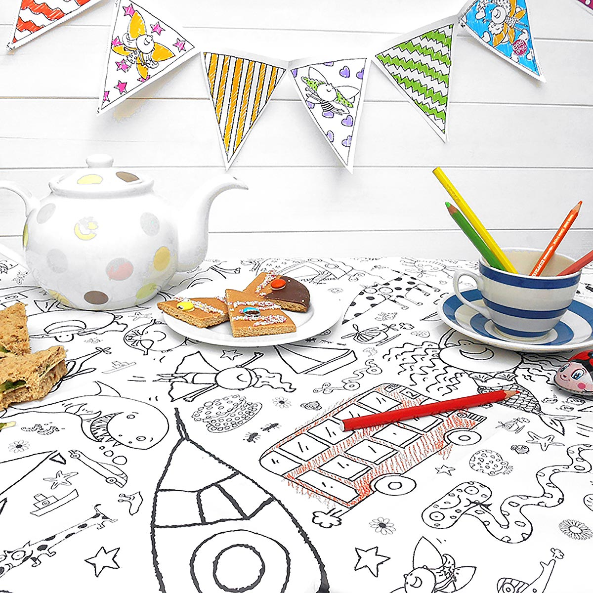 colour-in tablecloth with bunting and colouring pencils