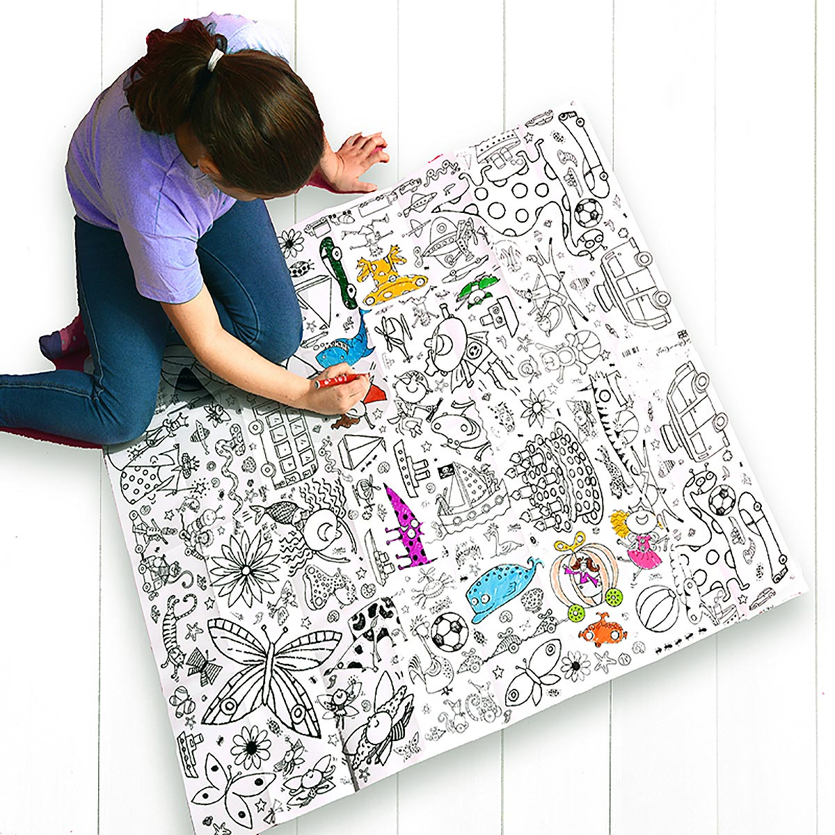 girl sitting on floor colouring tablecloth