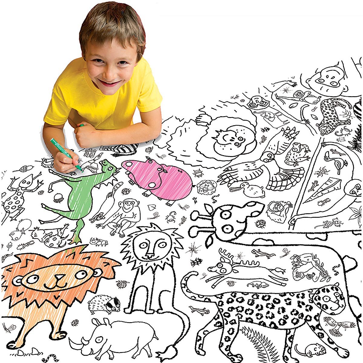 cheeky boy colouring in tablecloth