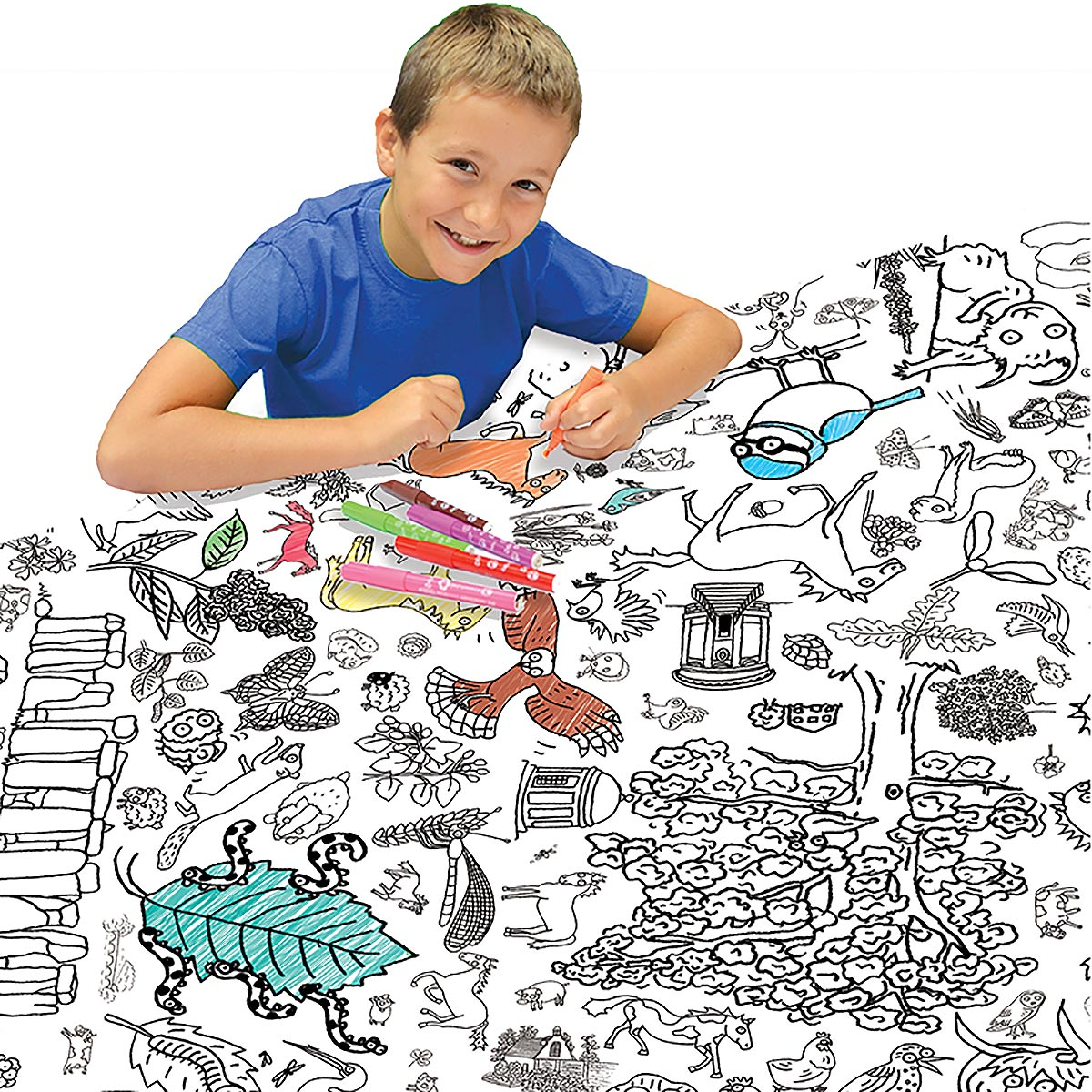 boy at table colouring in tablecloth