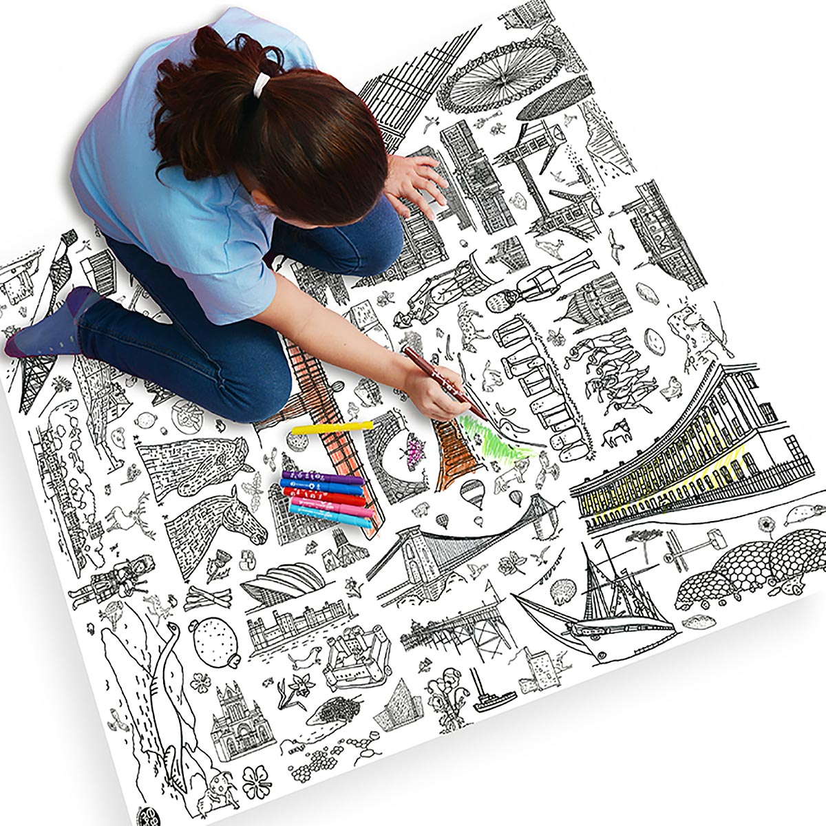 girl sitting on tablecloth colouring