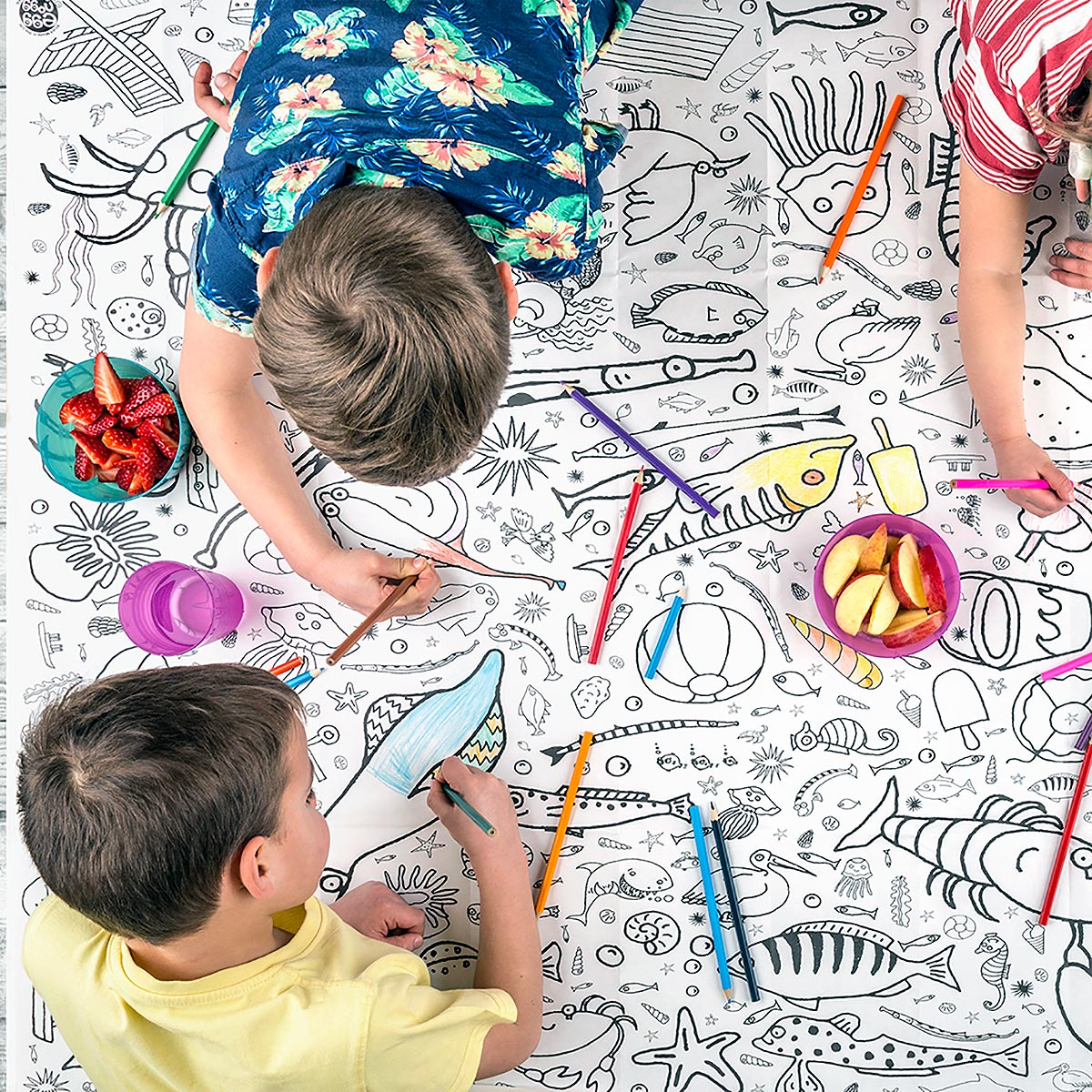 three children colouring tablecloth