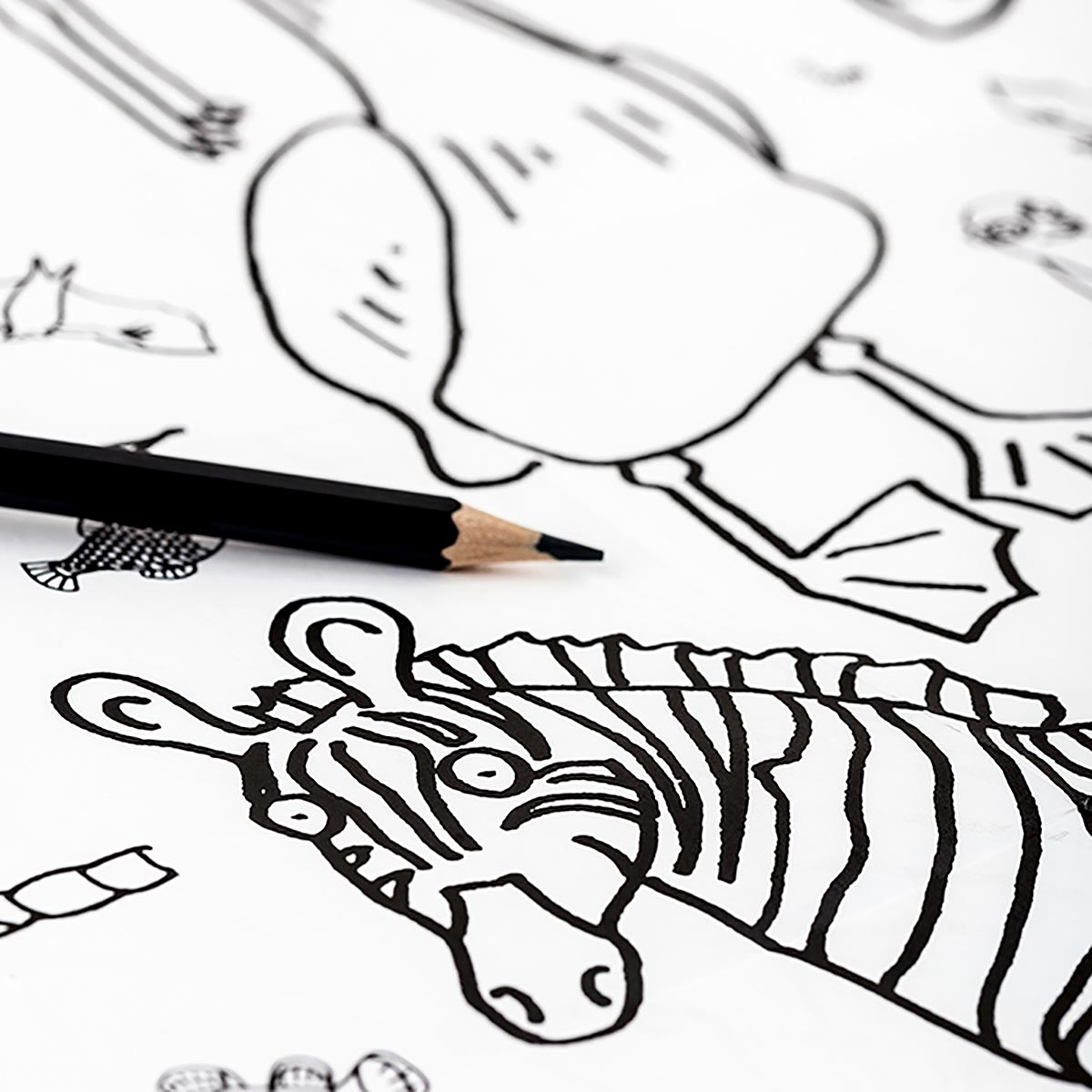 close up of zebra with crayon on tablecloth