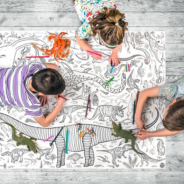 children lying on floor colouring tablecloth