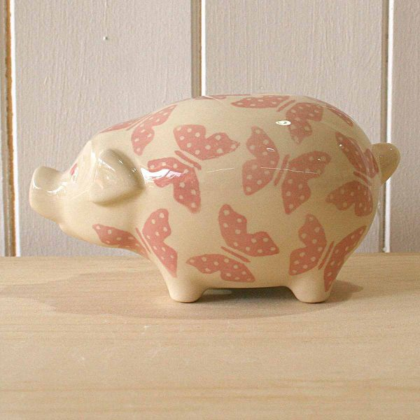 china pig on wood surface