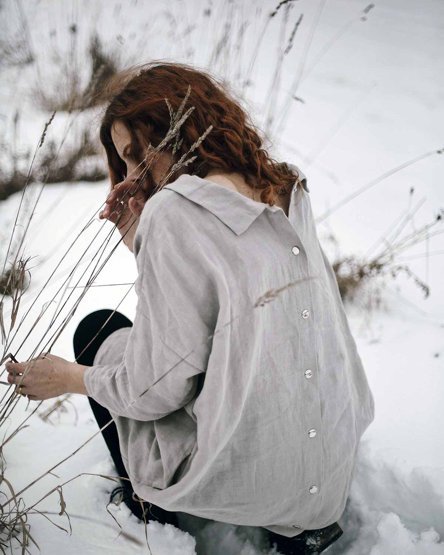 rear view girl wearing dress in snow