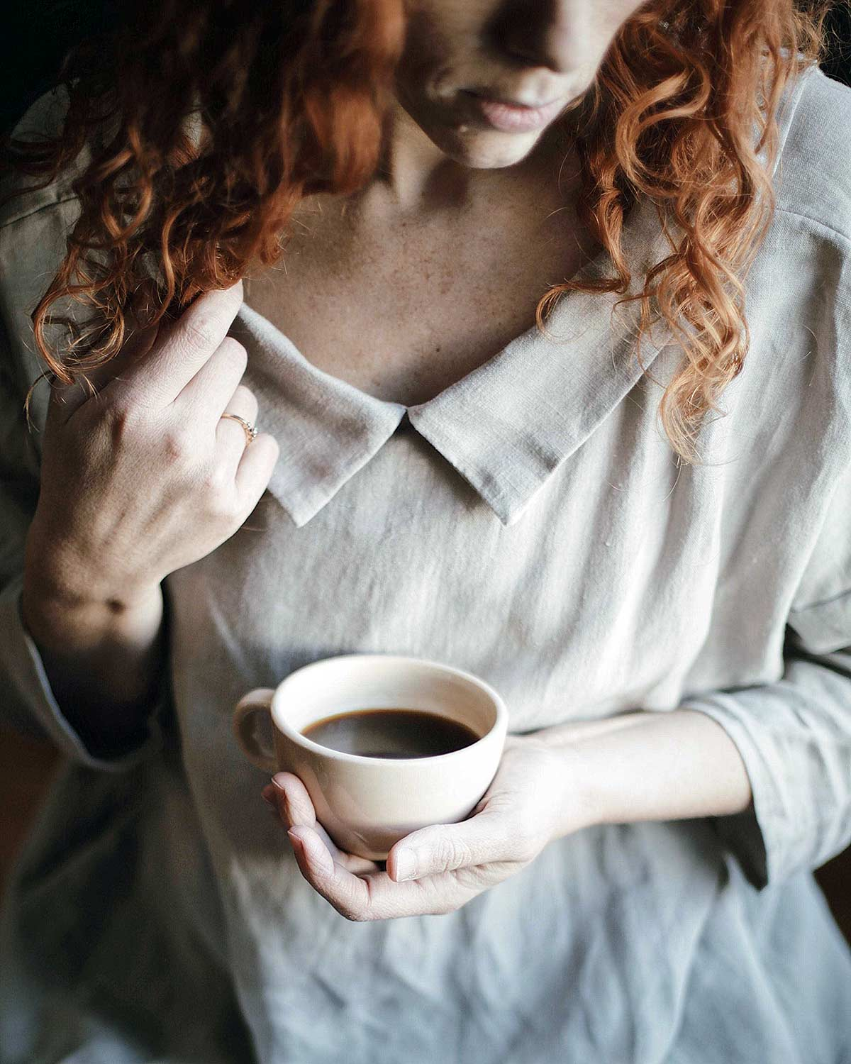 front view girl wearing dress and holding cup of coffee
