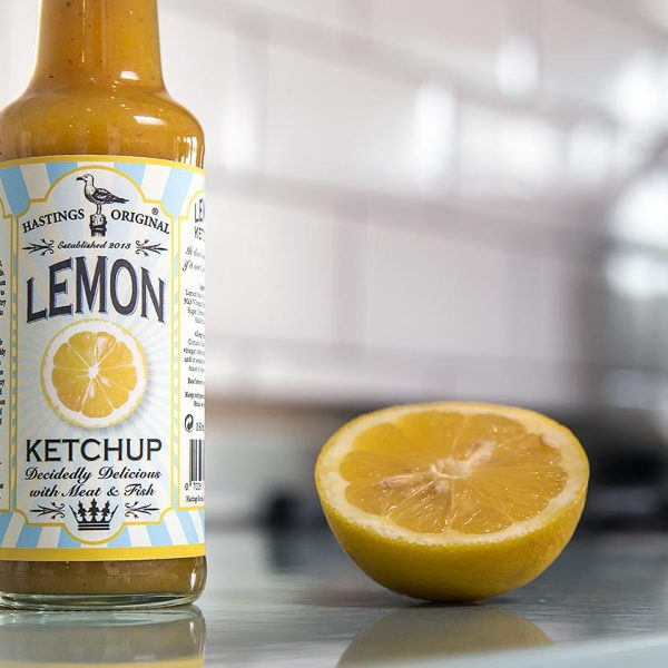 glass bottle on counter with cut lemon