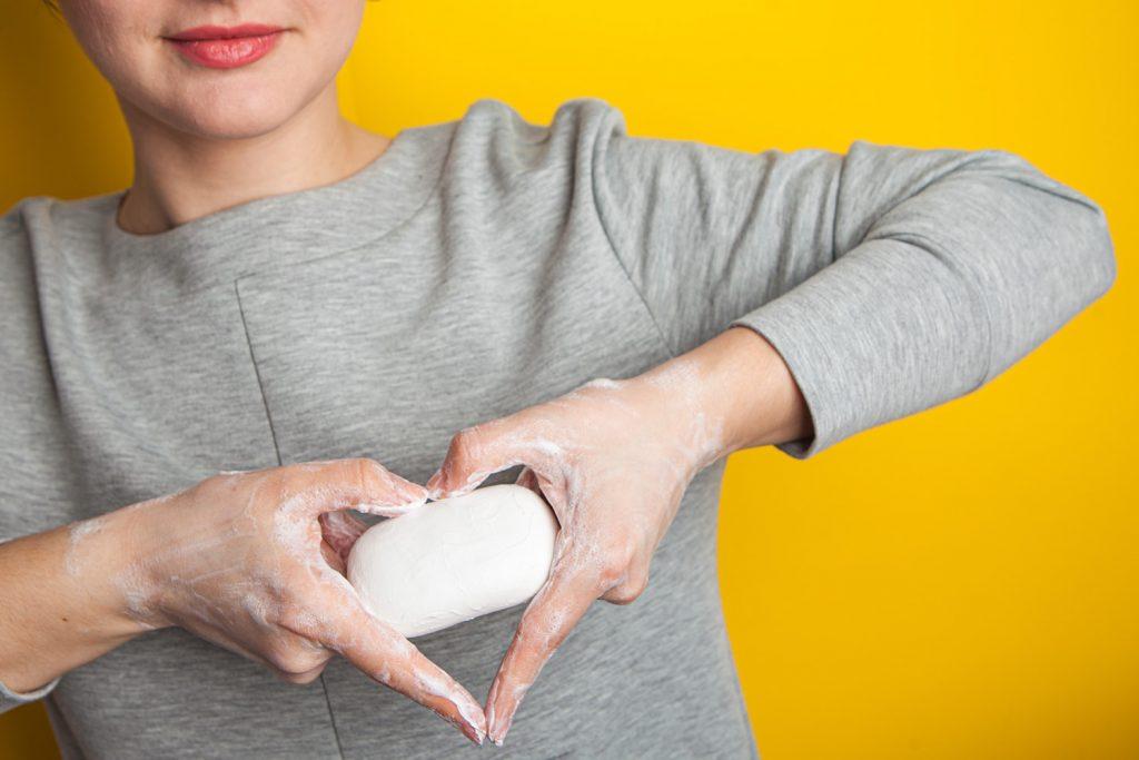 girl holding bar of soap