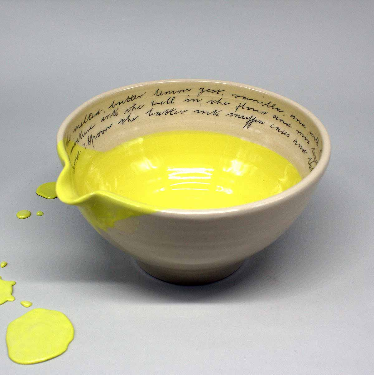 bowl and splat on white background