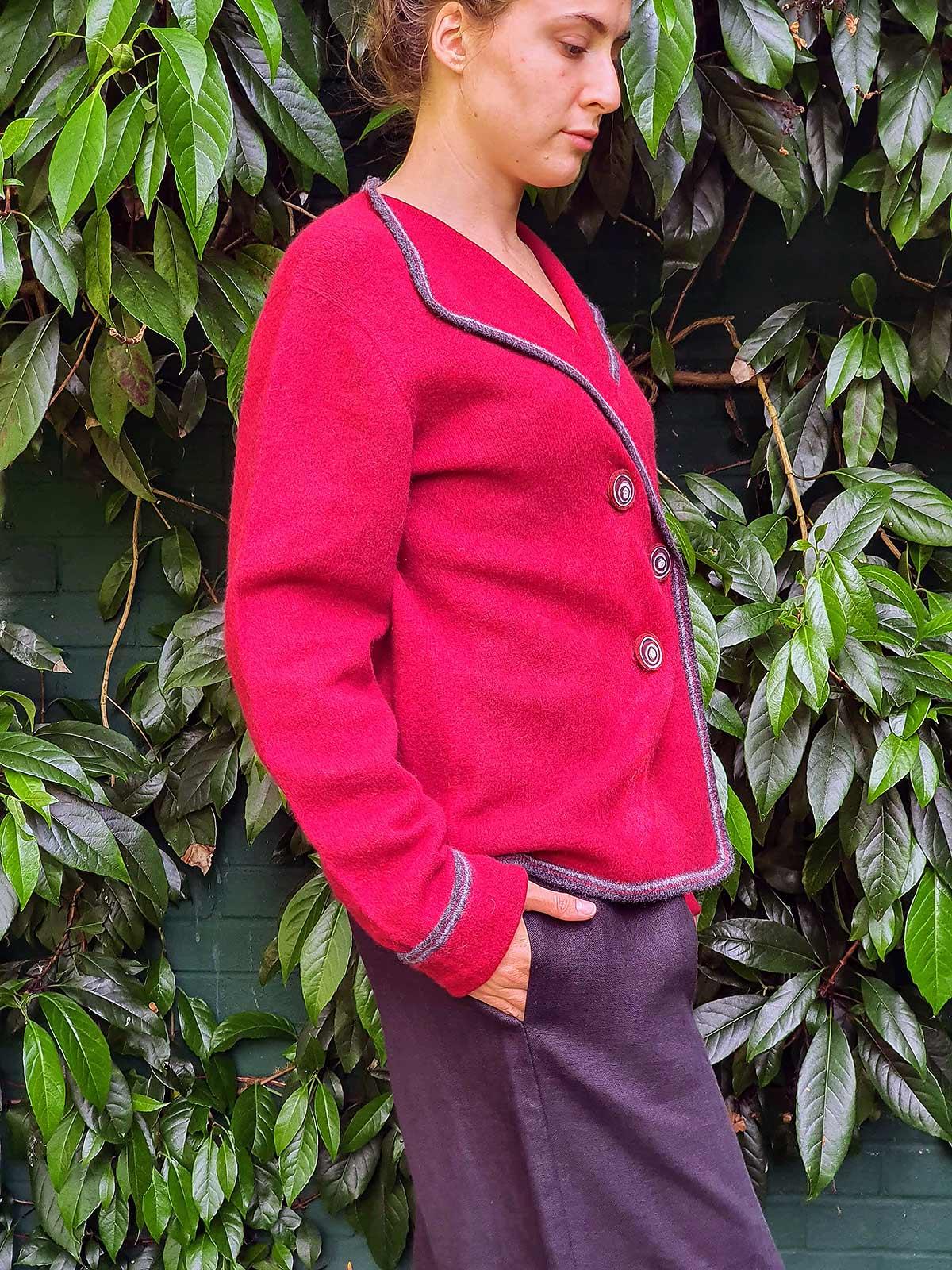 side view woman wearing jacket in garden