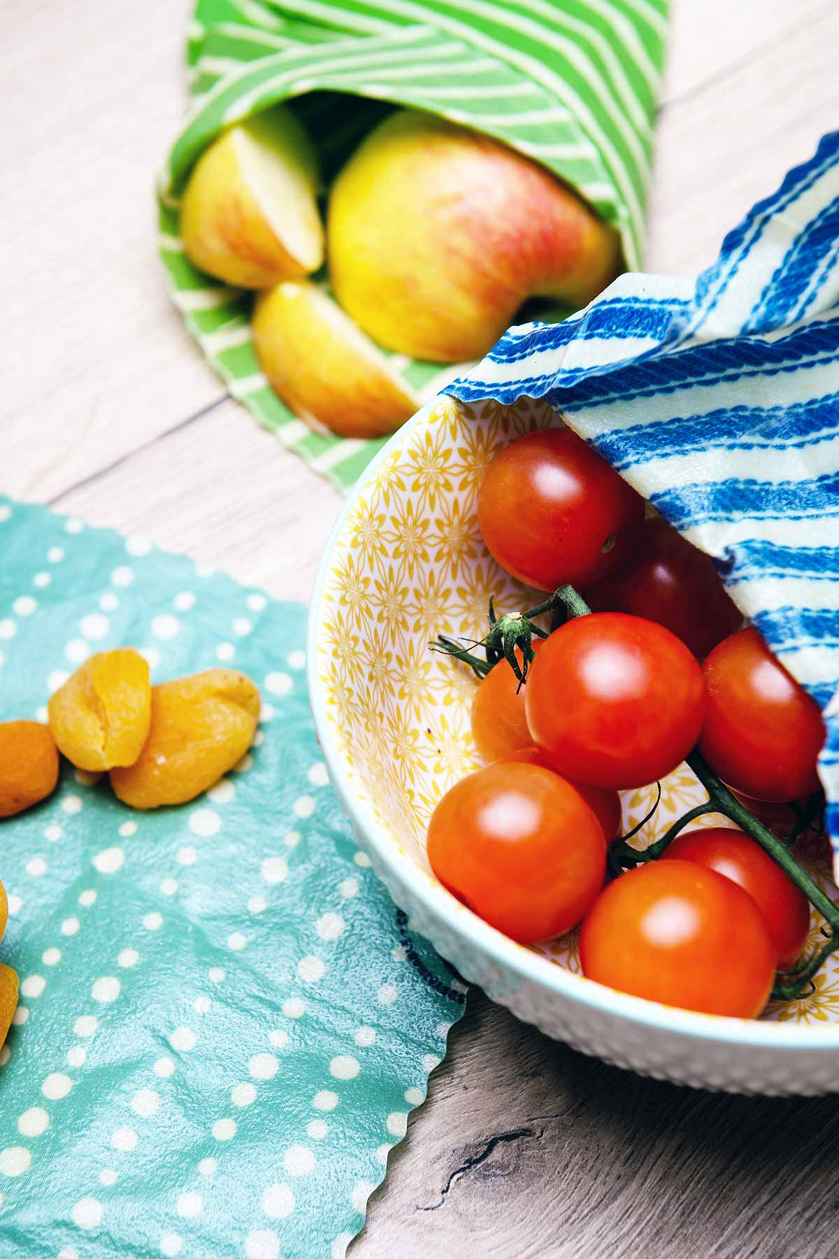 tomatoes in bowl and fruit on table