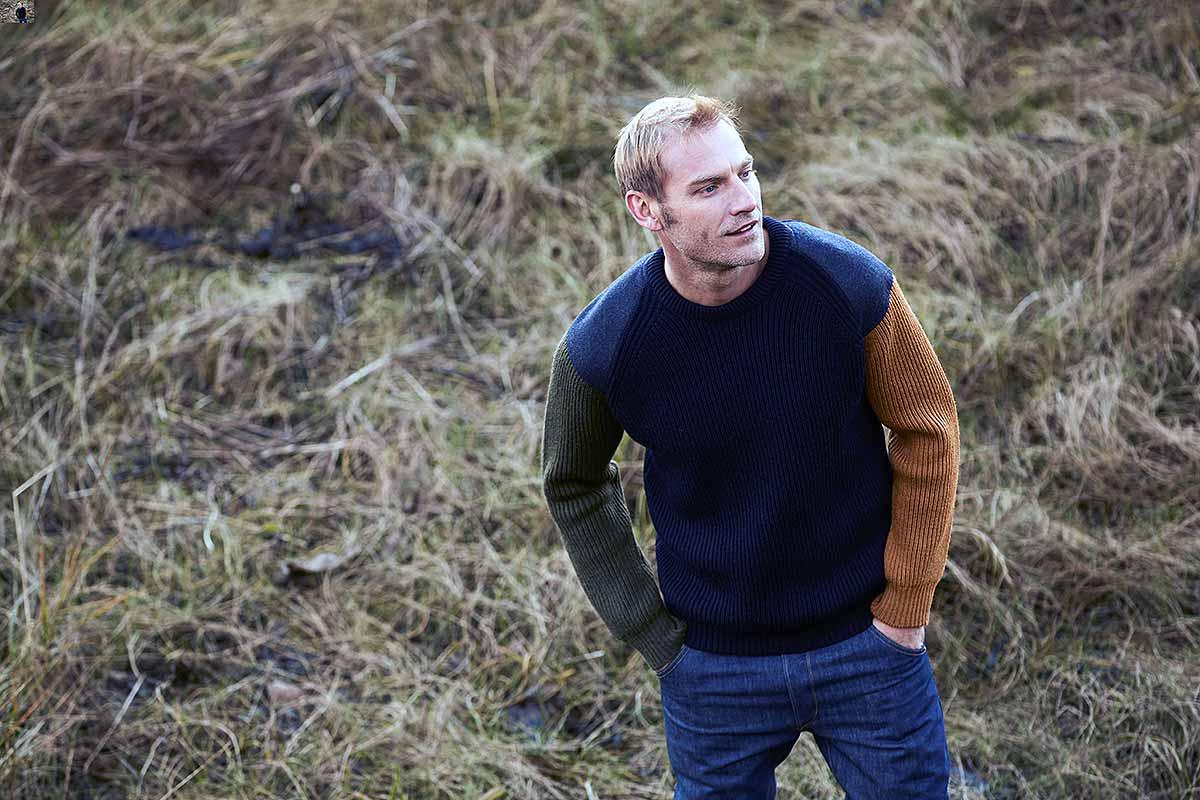 man wearing jumper in field