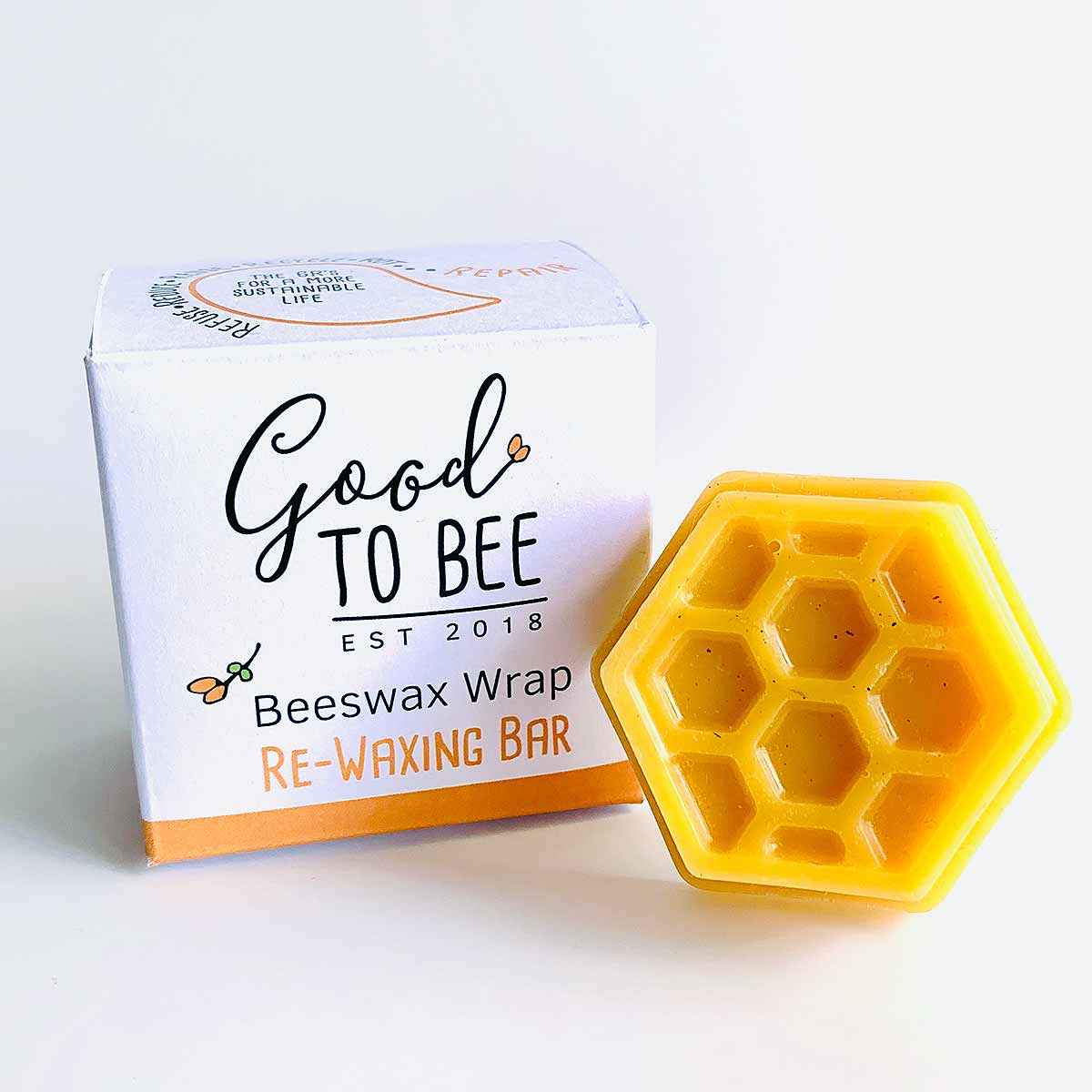 beeswax bar and box on white background