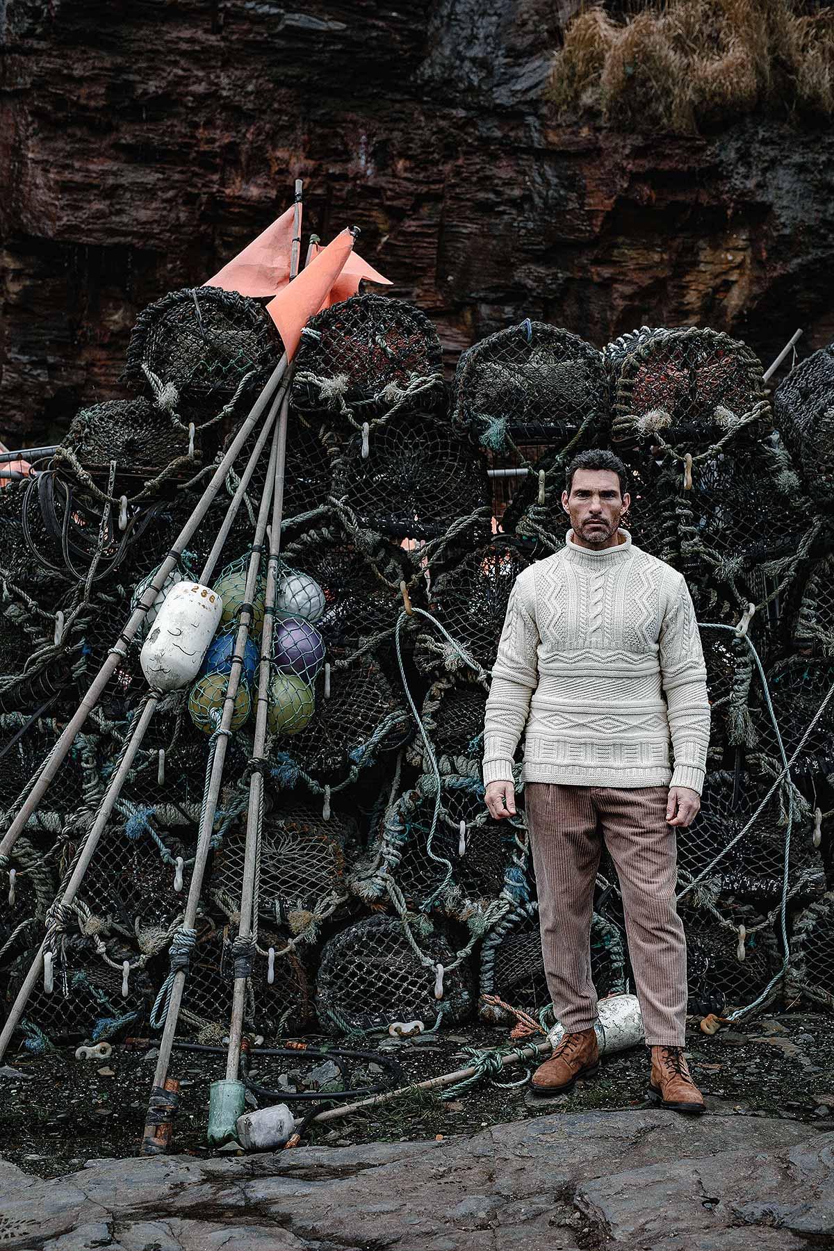 man wearing jumper next to nets