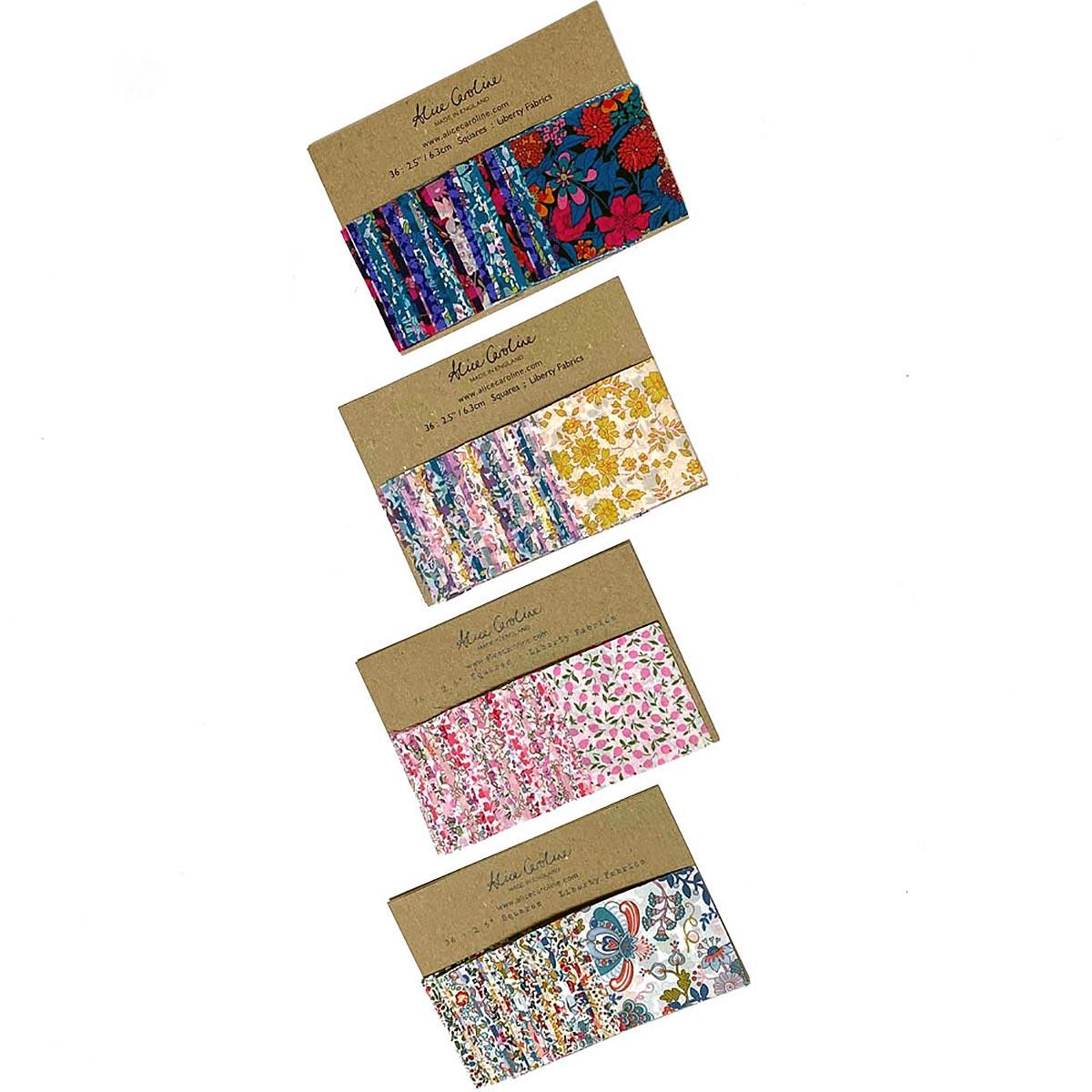 packs of square fabrics on white background