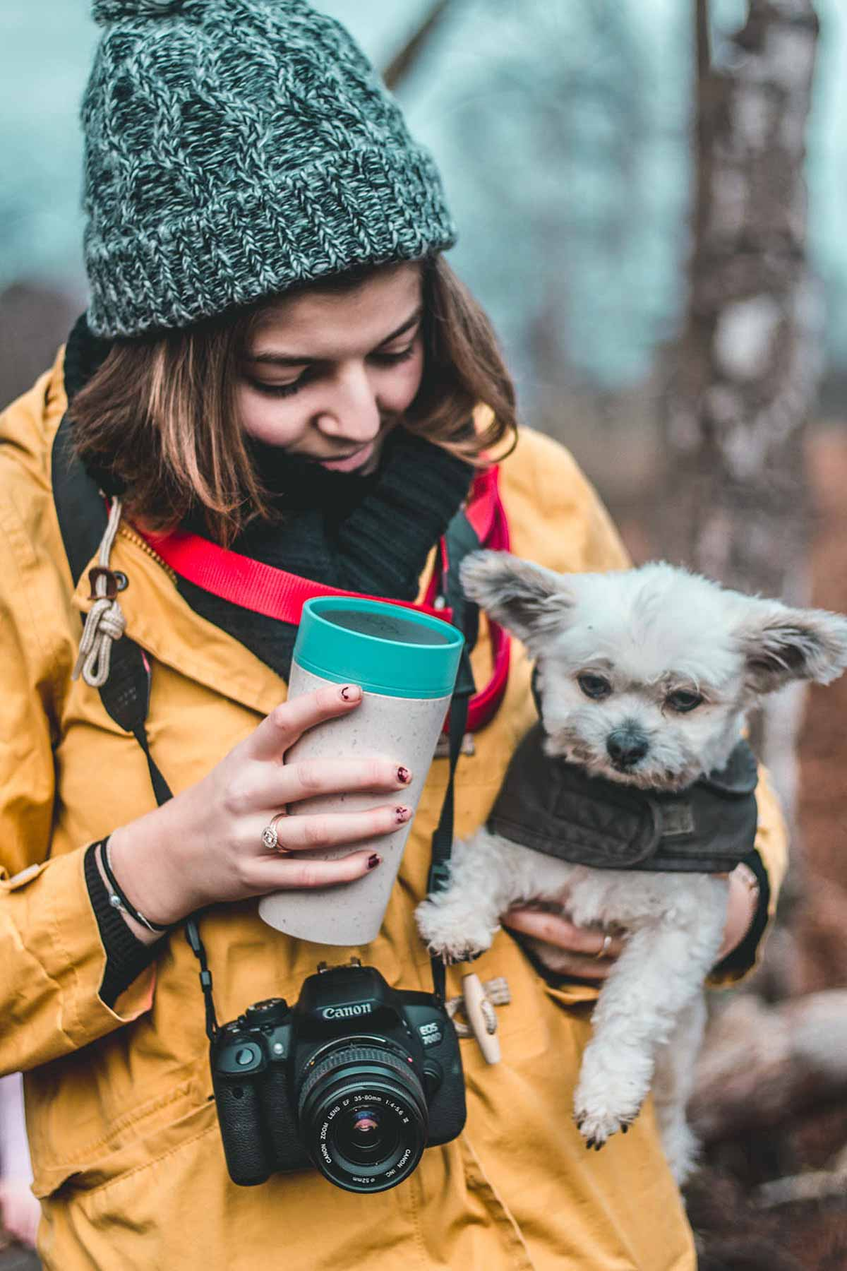 girl with dog holding cup