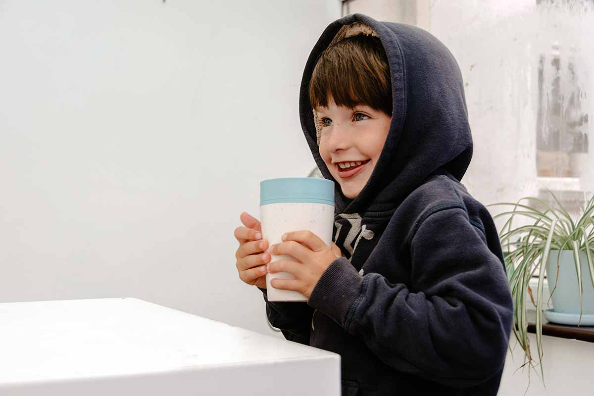 child holding cup
