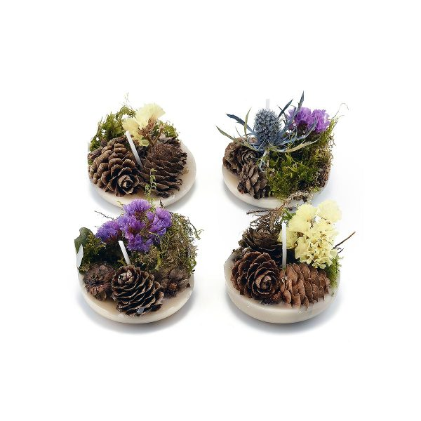 four decorated firelighters on white background