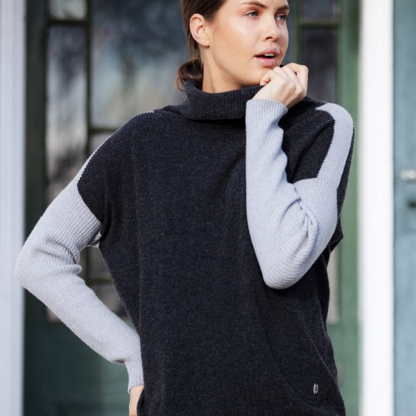 woman wearing jumper in front of door