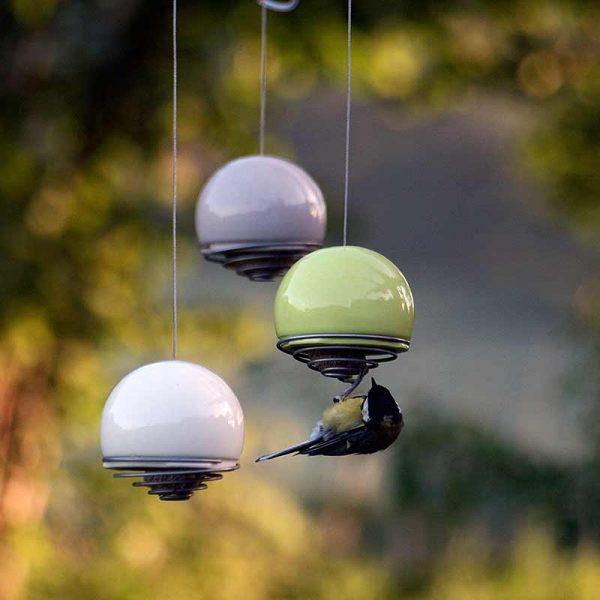 three bird balls hanging in garden